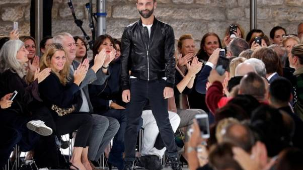 Louis Vuitton designer Ghesquiere signs new contract