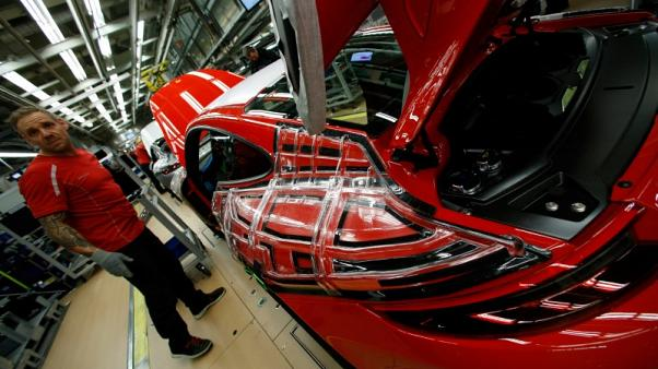 German factory growth hits 15-month low in May, PMI shows