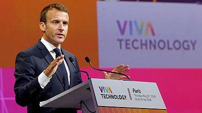 Wary of China, Macron urges Europe to set tech regulation standards
