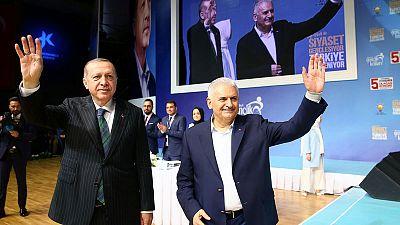 As lira tumbled, Turkey's prime minister won Erdogan over for rate hike