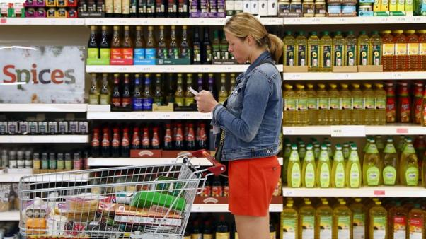 UK households less confident as economy worries grow - survey