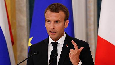 Macron meets in Russia with head of rights group, Solzhenitsyn's widow