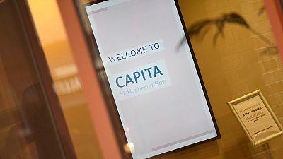 Capita raises 681 million pounds to pay down debt
