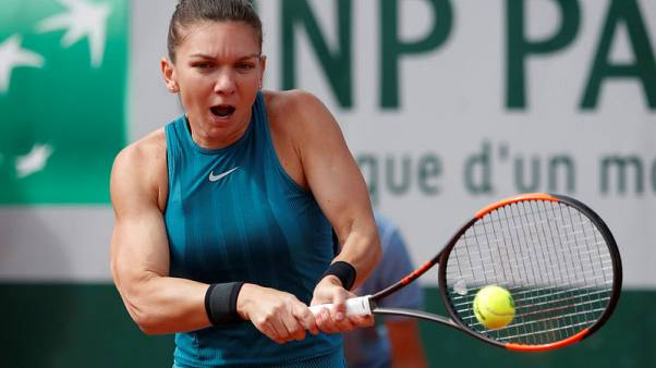 Halep subdues Petkovic after tight early tussle