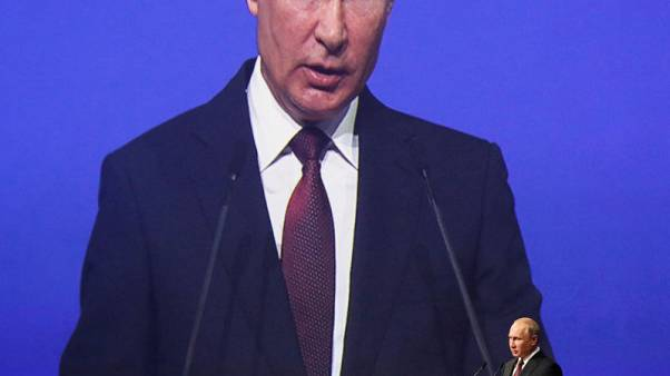 Putin says efforts to set up summit with Trump beset by problems