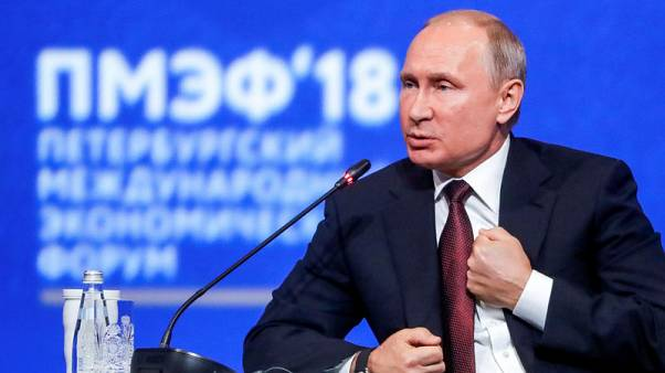 Russia's Putin - U.S. enforcement of own laws abroad unacceptable