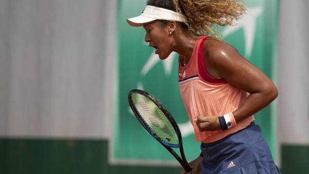Tennis - Osaka lost in her virtual world