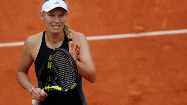 Wozniacki crushes Parmentier to reach fourth round
