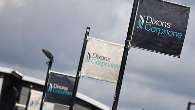 Dixons Carphone warns on profit, to close stores