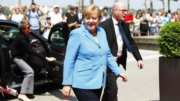 Merkel says political hate speech is 'playing with fire'