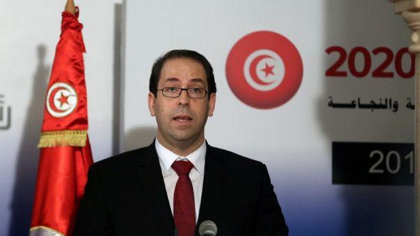 رئيس وزراء تونس يتهم ابن الرئيس بتدمير الحزب الحاكم وتصدير أزمته لمؤسسات الدولة