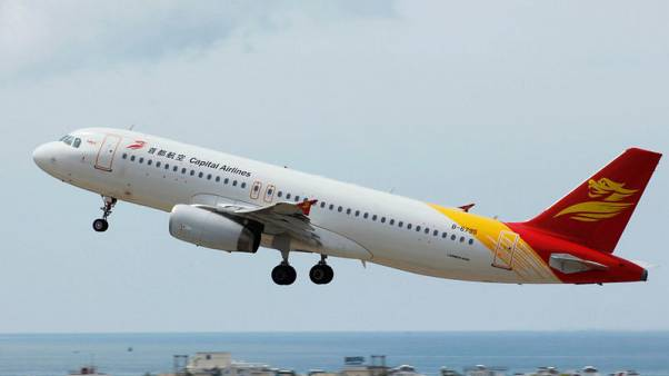 Capital Airlines flight turns around in China after cracks appear in window - Xinhua