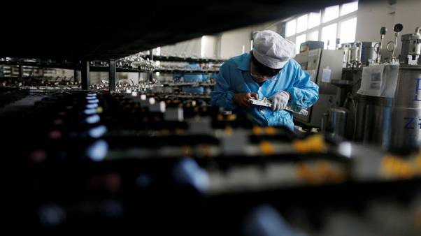 China May official factory growth at eight-month high, well above forecasts