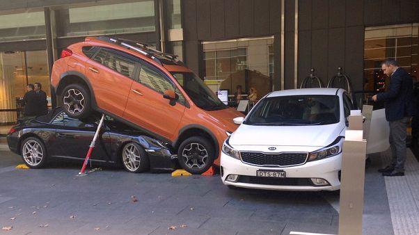 Caught in a pile-up: Sydney valet parks Porsche under SUV