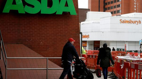 Ahead of Sainsbury's takeover, Asda says results on track