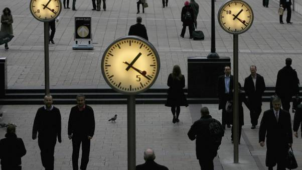 UK funds trim equity exposure, up cash in volatile May