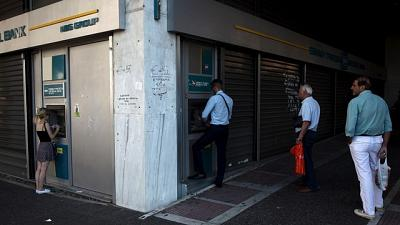 Greece eases capital controls, raises monthly cash withdrawal limit