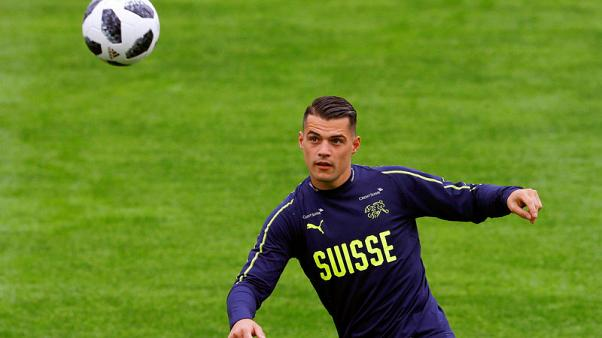 Swiss Xhaka relieved after escaping with bruised knee