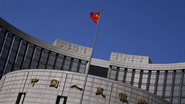 China holds fire on rates, posts 'shockingly weak' activity growth