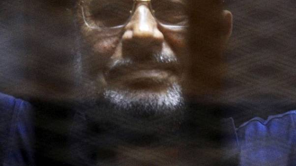 محكمة مصرية تلغي أحد حكمين بإدراج مرسي وأبو تريكة على قائمة الإرهابيين