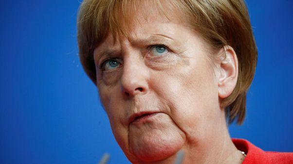 ميركل: ألمانيا ملتزمة بالاتفاق النووي الإيراني وعلى الشركات حسم أمرها