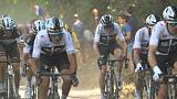 Froome and company grind through the cobbles