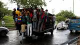 Weary Venezuelans rely on 'dog cart' transports as buses succumb to crisis