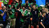 Mondial: la Croatie invite le photographe de l'AFP submergé par ses joueurs