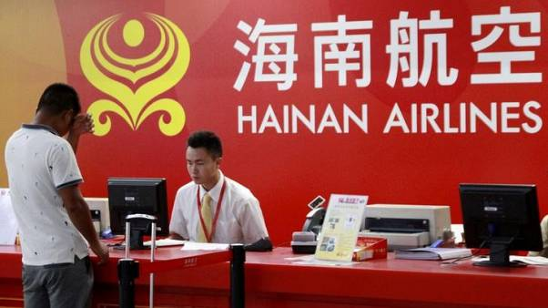 China's Hainan Airlines slumps after lifting trading suspension