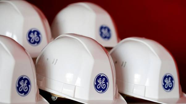 GE beats diminished profit expectations, trims cash flow target