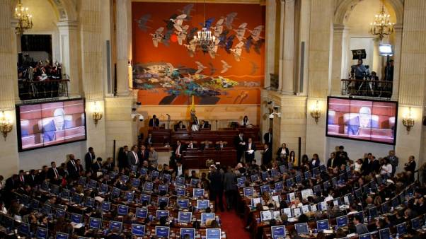 Colombia's Santos urges peace as FARC take seats in Congress