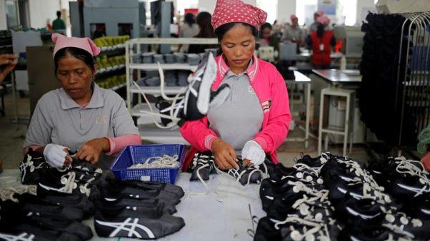 Hardworking Cambodian shoe maker has little time for politics