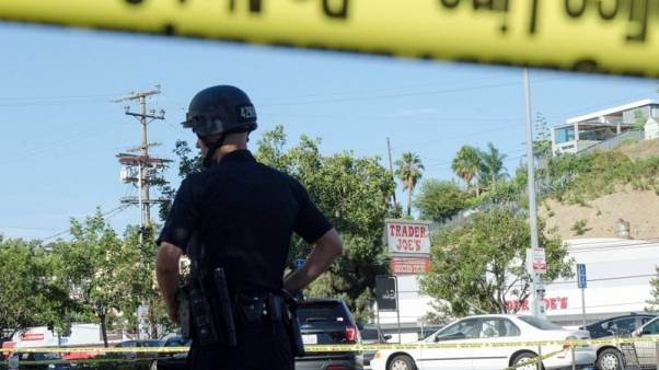 Gunman arrested after deadly Los Angeles store hostage standoff
