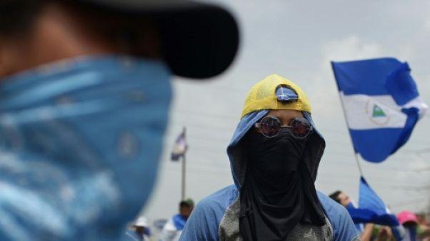 Des opposants au gouvernement manifestent à Managua, le 22 juillet 2018