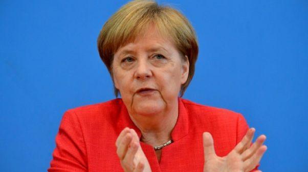 Mme Angela Merkel s'exprimant devant la presse à Berlin, le 20 juillet 2018