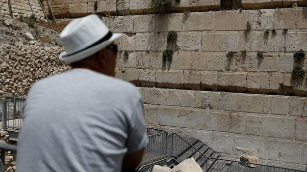 Boulder falls from Jerusalem's Western Wall, barely missing worshipper
