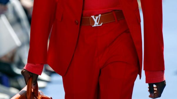 Vuitton owner LVMH posts rise in first half profits