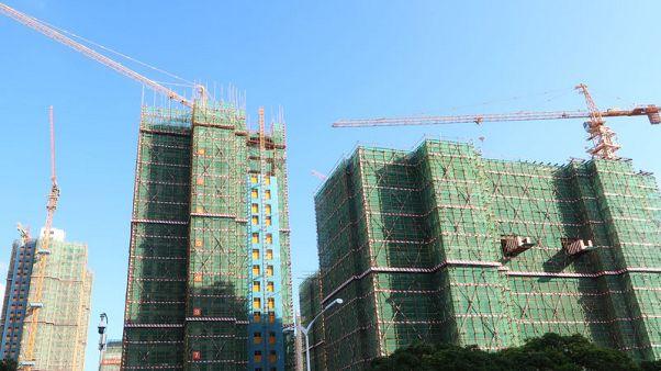 In China's debt-laden Xiamen, real estate boom chokes consumption