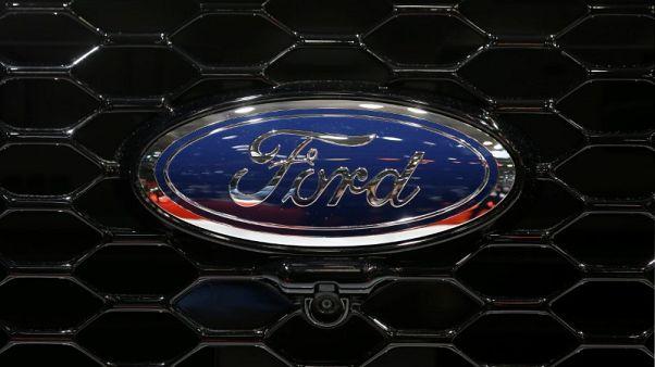 Ford cuts 2018 profit forecast; tariffs, China sales hurt second quarter