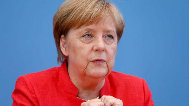 Opposition parties blast Merkel over meeting with Russian officials