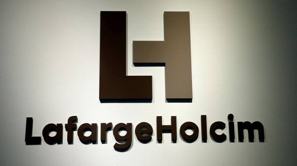 LafargeHolcim first-half profit drops 43 percent as restructuring charges bite