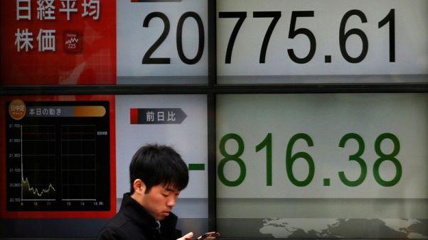 المؤشر نيكي يغلق مرتفعا والأنظار على التجارة واجتماع المركزي الياباني