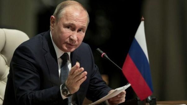 """Poutine dit être """"prêt à se rendre à Washington"""" et avoir invité Trump à Moscou"""
