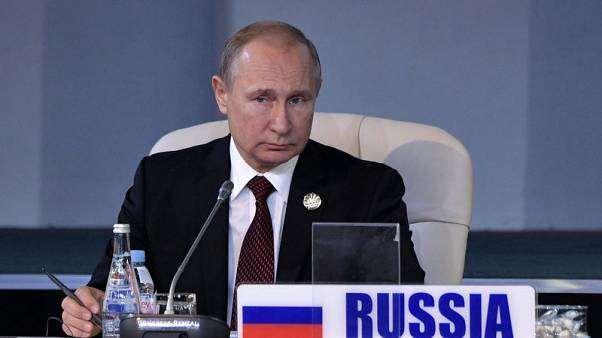 Russia's Putin tells Trump - 'Be my guest in Moscow'