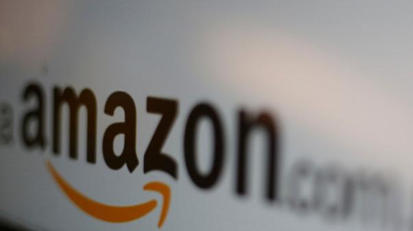 Amazon shares hit record high as profit tops $2 billion for first time