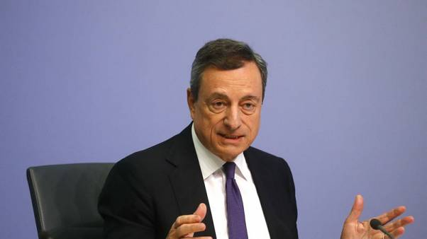 Draghi's pledge on low interest rates hits euro, lifts bonds