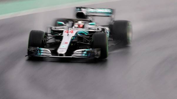 Hamilton beats the elements to seize pole in wet Hungary