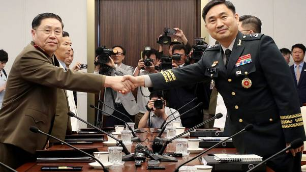 Two Koreas discuss reducing military tension amid reports of North Korea missile activity
