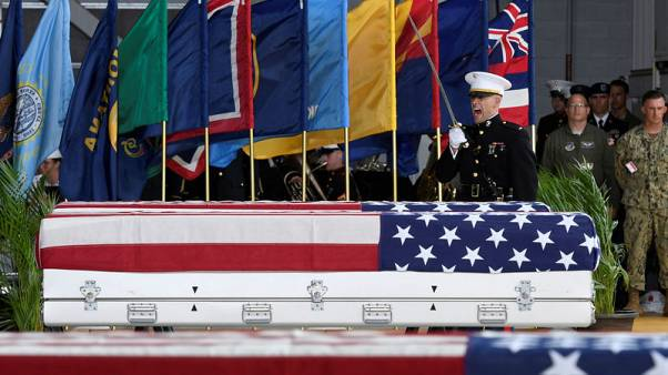 U.S. welcomes home remains of presumed war dead from North Korea