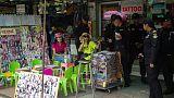 Thai vendors ignore ban on road stalls in Bangkok backpacker street